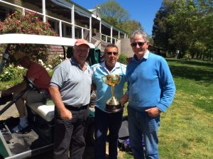 Neil Peterson, Bill Dredge and Sam Wright with the Monthly Medal, no it's the Melbourne Cup!